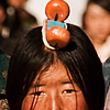 Head Piece Photo: Traditional Tibetans with unique head ornamentation walk the Barkhor.