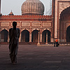 Sacred Sandstone Photo: A Muslim man walks out the east entrance of Delhi's Jama Masjid (Main Mosque).