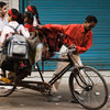 The Short Rickshaw Photo: A gaggle of elementary school girls pile into a cycle rickshaw to get their learn on.