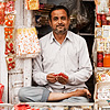 Indian Style Photo: A store owner sits cross-legged in the cramped quarters of his jewelry store.