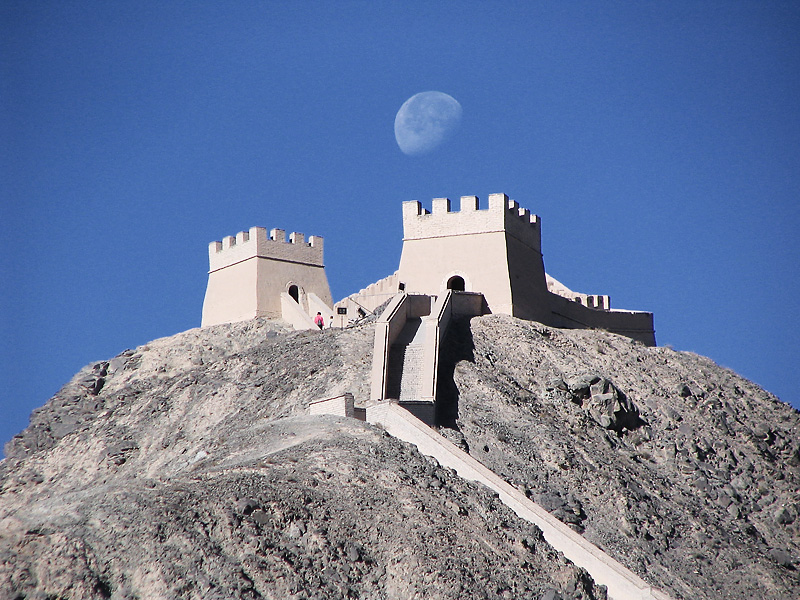 The moon sets over the far western end of one section of the Great Wall of China. - Jiayuguan, Gansu, China - Daily Travel Photos