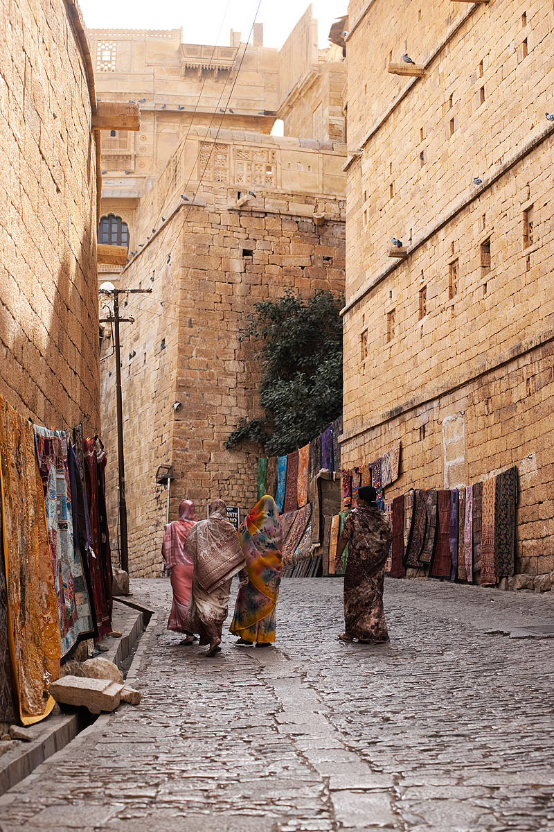 Saree-clad Indian women walk up the ramp into the entrance of the Jaisalmer fort. - Jaisalmer, Rajasthan, India - Daily Travel Photos