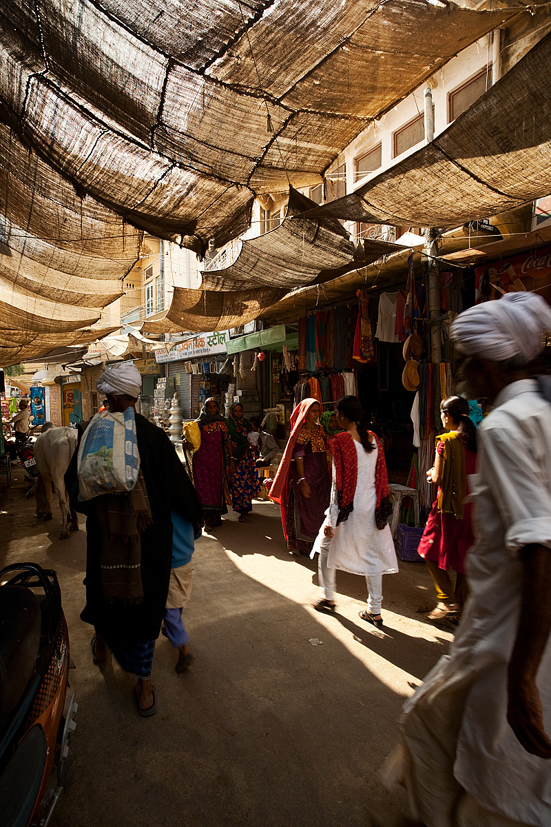 Traditionally dressed Rajasthanis walk through the Jaisalmer's bazaar. - Jaisalmer, Rajasthan, India - Daily Travel Photos