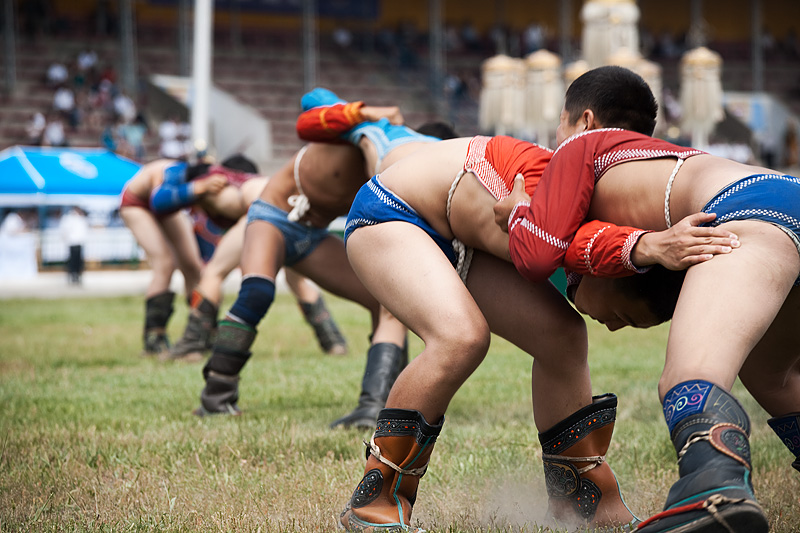 Three simultaneous wrestling matches during the Nadaam Festival.  - Ulaan Baatar, Mongolia - Daily Travel Photos