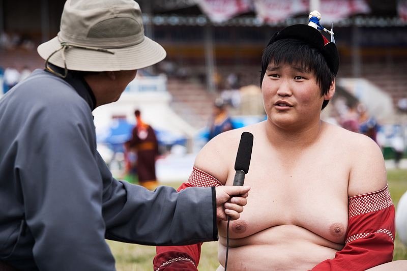 A heavyweight boy squirms under the spotlight of a televised interview. - Ulaan Baatar, Mongolia - Daily Travel Photos