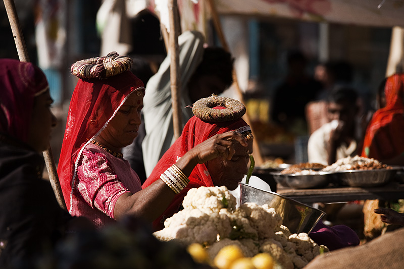 Halo wearing Rajasthani women shop for vegetables at the main market. - Jodhpur, Rajasthan, India - Daily Travel Photos