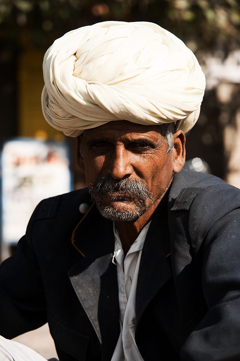A portrait of a ruggedly handsome, turban-clad Rajasthani man. - Jodhpur, Rajasthan, India - Daily Travel Photos