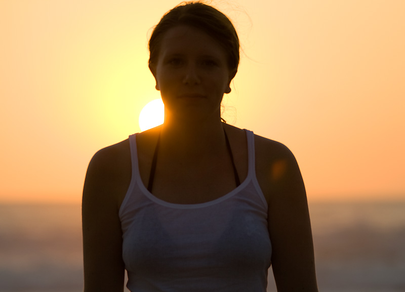 The sun sets behind my German friend in Bali's famed Kuta beach. - Kuta, Bali, Indonesia - Daily Travel Photos