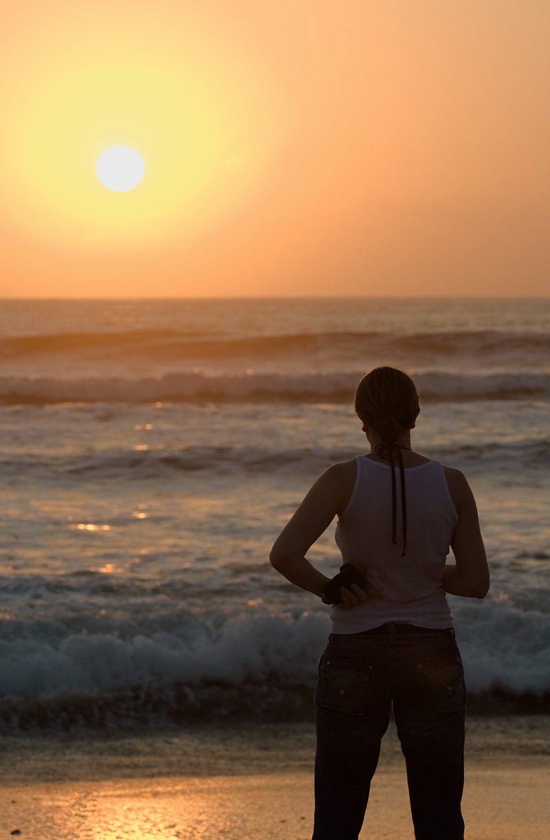 A German friend watches the sun set into the ocean. - Kuta, Bali, Indonesia - Daily Travel Photos