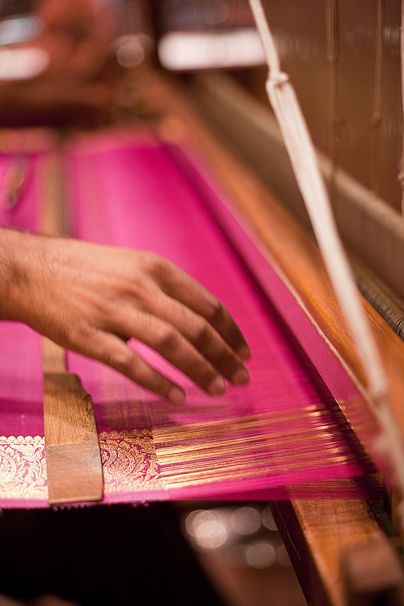 The weaver's hand awaits an incoming shuttle. - Tirunelveli, Tamil Nadu, India - Daily Travel Photos