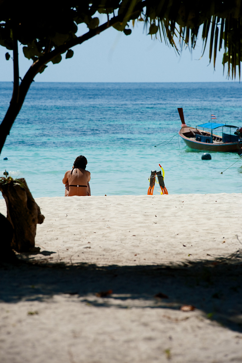A French woman awaits the end of another beautiful day at the beach. - Ko Lipe, Thailand - Daily Travel Photos