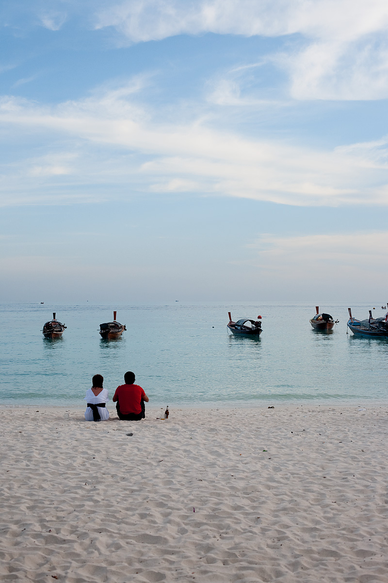A Spanish couple enjoys an evening of drinks overlooking the ocean. - Ko Lipe, Thailand - Daily Travel Photos