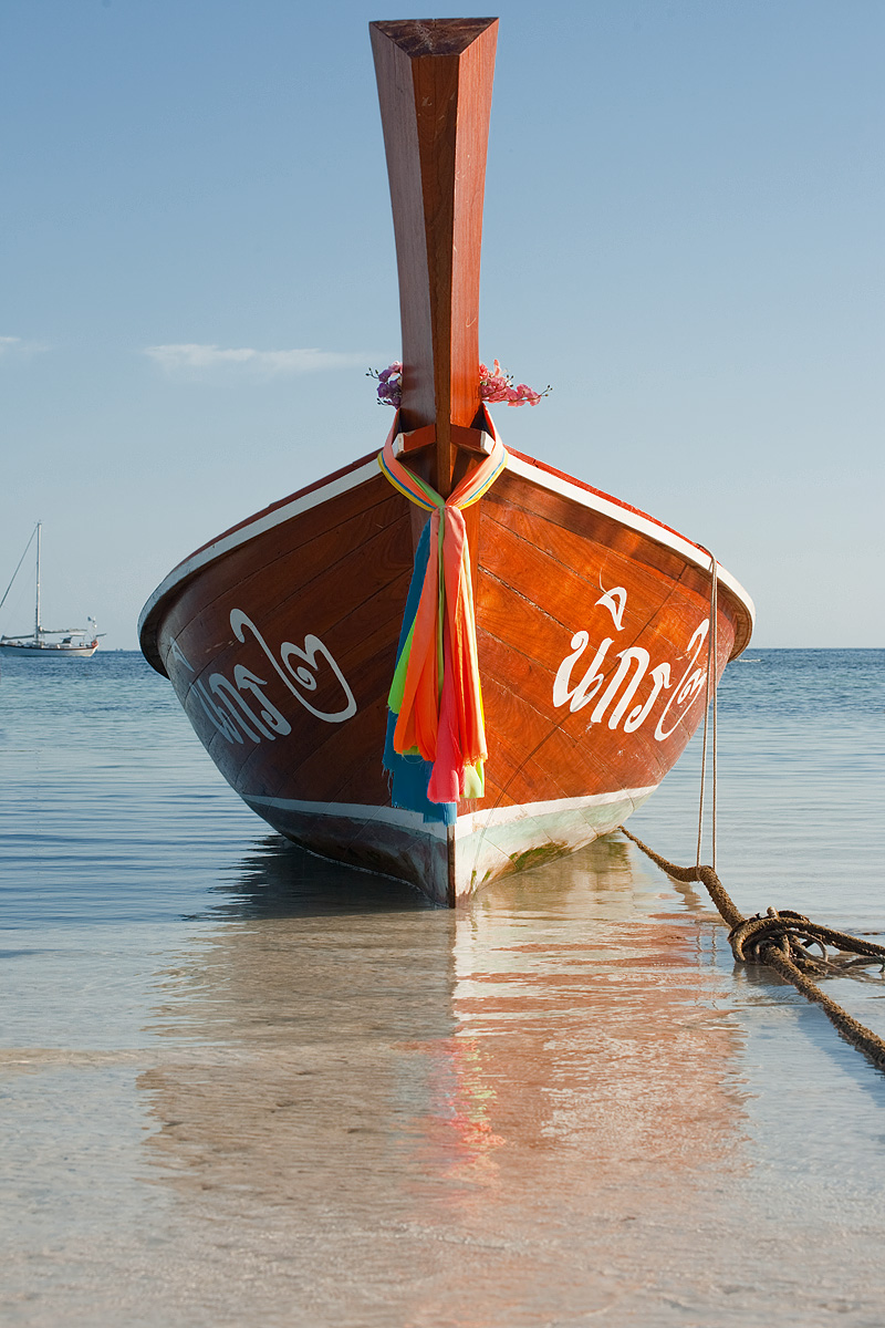 Ribbons tied on the bow of a longtail boat in low tide. - Ko Lipe, Thailand - Daily Travel Photos