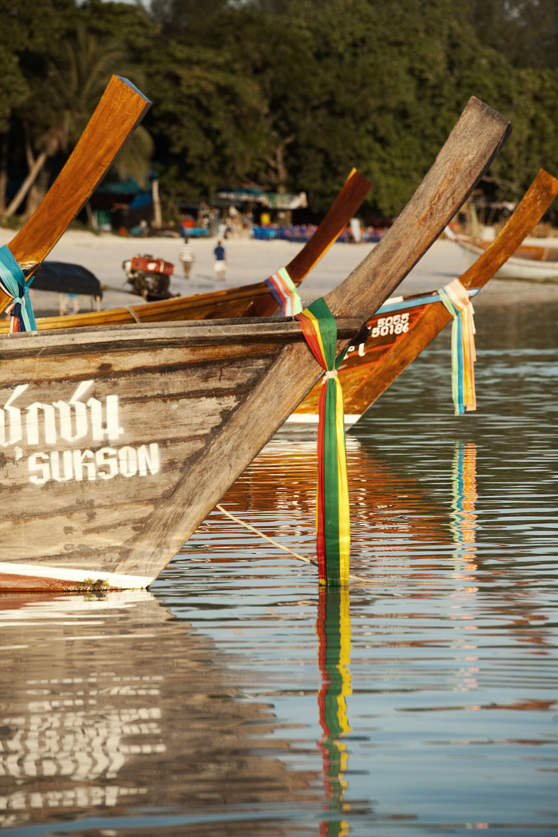 Ribbons hang off the bows of longtail boats. - Ko Lipe, Thailand - Daily Travel Photos