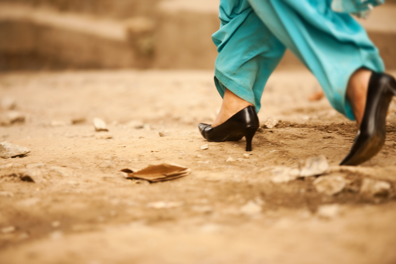 High heels on an littered unpaved road. - Gangtok, Sikkim, India - Daily Travel Photos