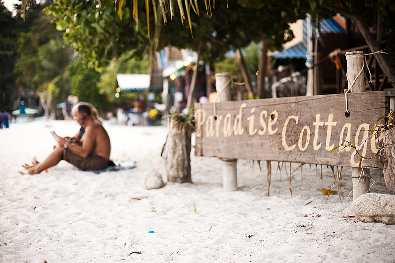 Vacationers use a wifi connection on the beach to video chat with their loved ones. - Ko Lipe, Thailand - Daily Travel Photos