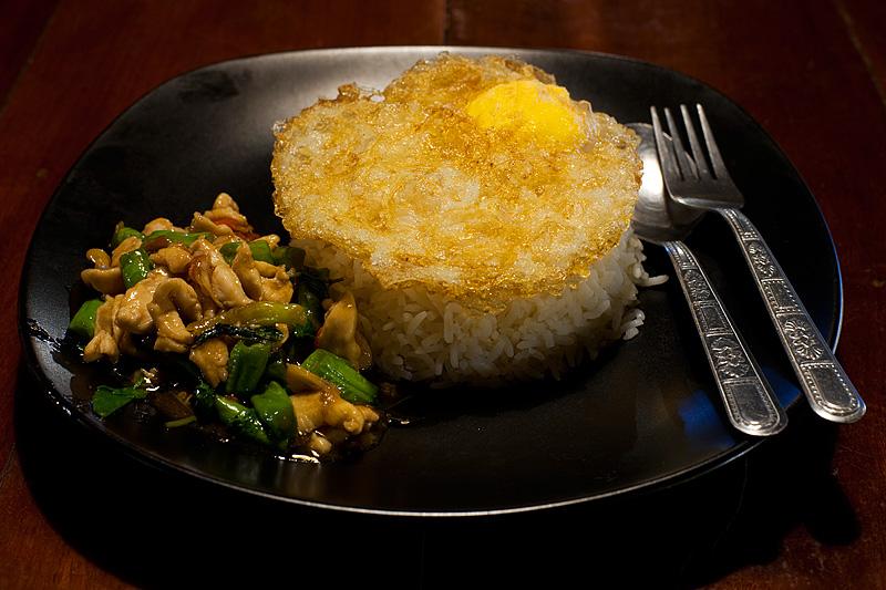 Phad Ka Prao: Spicy basil leaf chicken Thai food with deep-fried egg. - Ko Lipe, Thailand - Daily Travel Photos