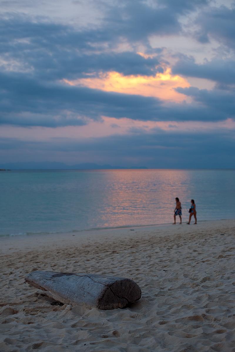 Vacationers walk the beach at sunset. - Ko Lipe, Thailand - Daily Travel Photos
