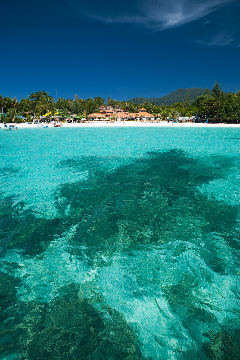 Coral silhouettes mark the bottom of the crystal clear water of Pattaya beach looking onto Sita Resort. - Ko Lipe, Thailand - Daily Travel Photos