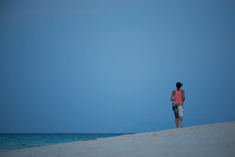A vacationing jogger on Mountain Resort's beach. - Ko Lipe, Thailand - Daily Travel Photos