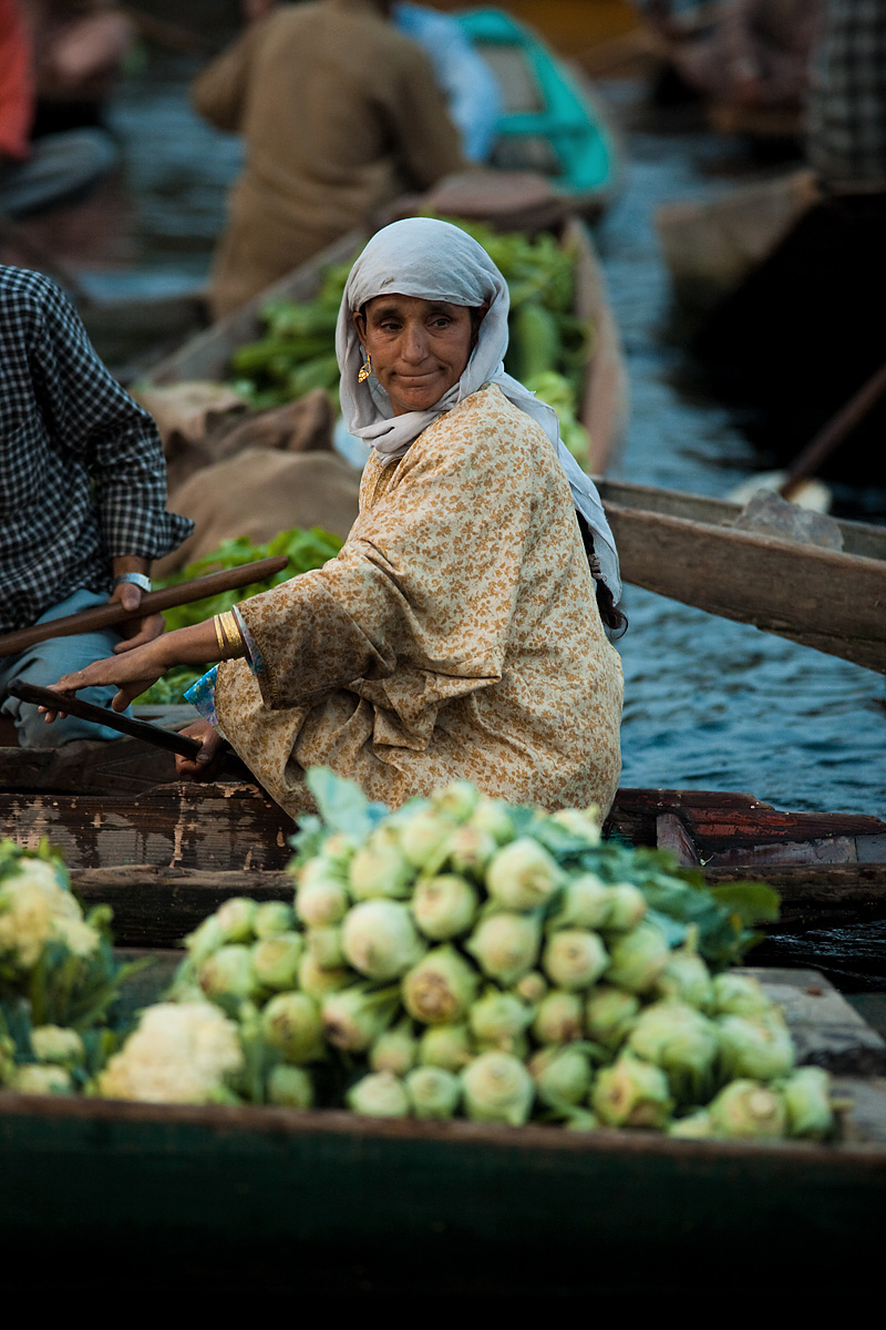 A lone female vegetable shopper browses the boats' selections at the floating vegetable market. - Srinagar, Kashmir, India - Daily Travel Photos