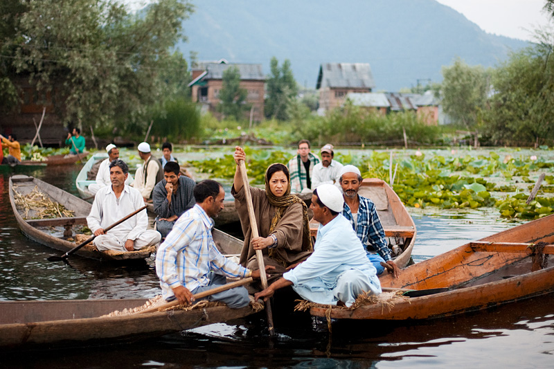A Kashmiri woman is physically barred from boating away at the floating vegetable market. - Srinagar, Kashmir, India - Daily Travel Photos