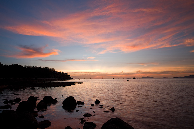 The setting sun brightens the clouds and the bordering islands - Ko Lipe, Thailand - Daily Travel Photos