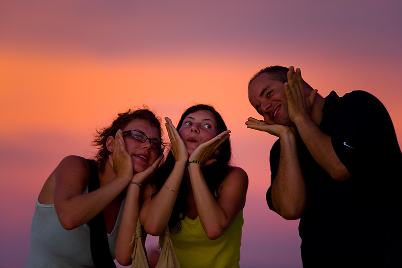 Two Swedes and a Swiss pose under a fully purple and orange sky. - Ko Lipe, Thailand - Daily Travel Photos