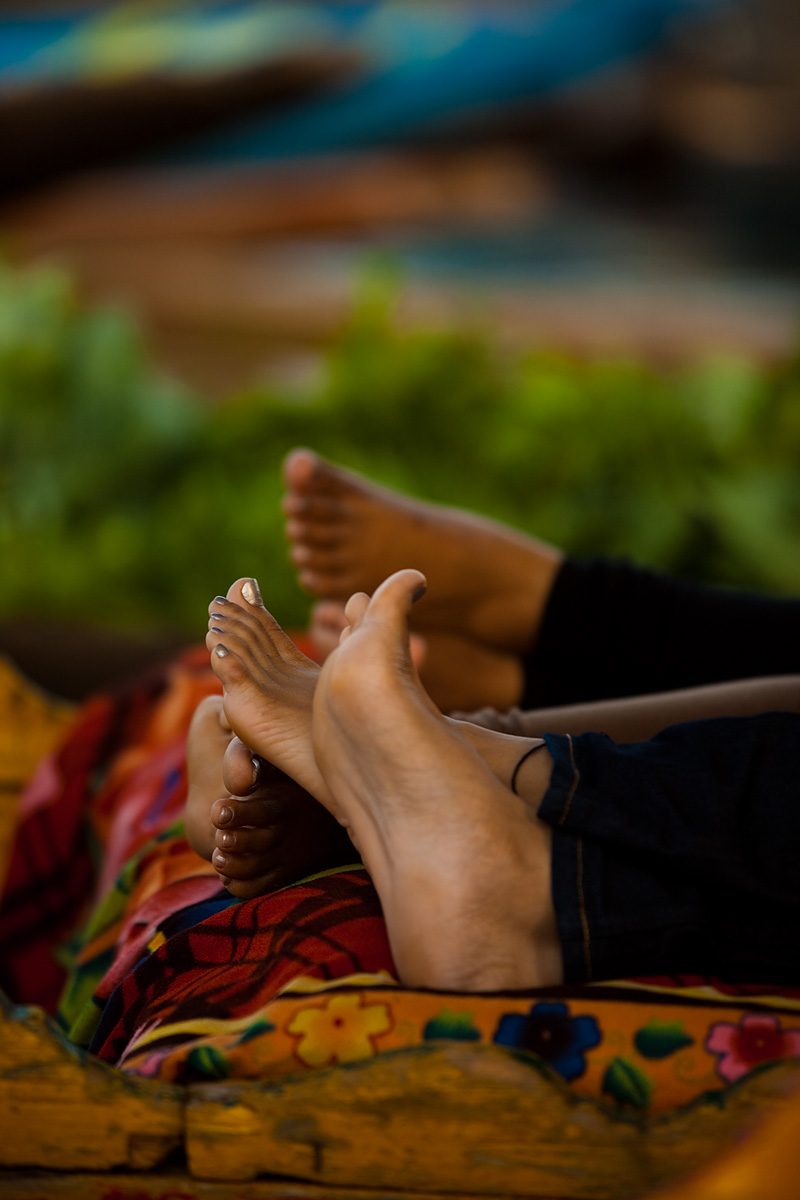 The feet of Indian tourists at the floating vegetable market. - Srinagar, Kashmir, India - Daily Travel Photos