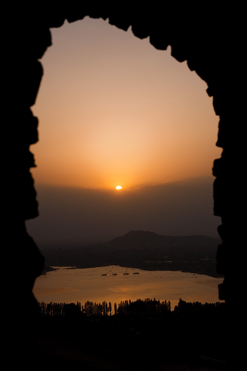 The Srinagar Fort and Dal Lake seen through a stone gate Pari Mahal at Sunset. - Srinagar, Kashmir, India - Daily Travel Photos