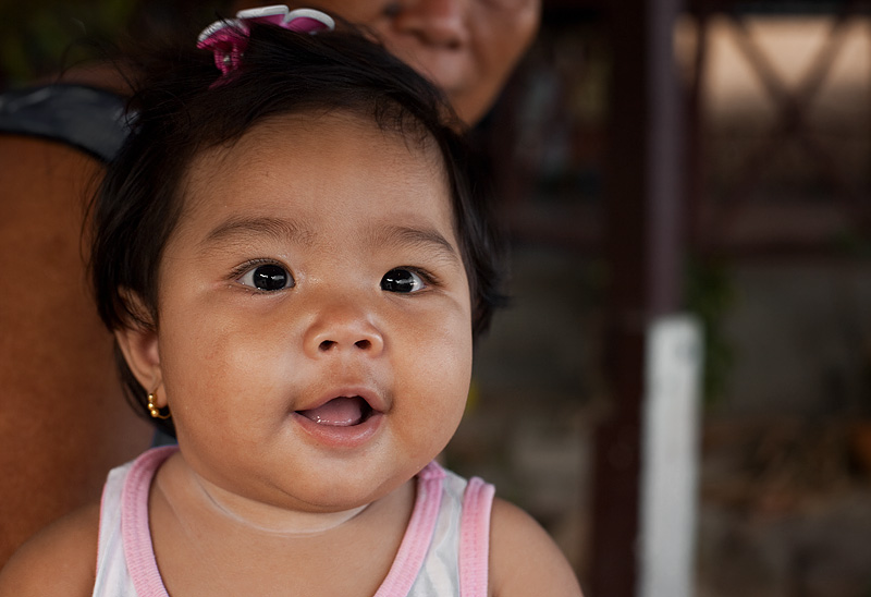 A smiling Chao Leh sea gypsy baby. - Ko Lipe, Thailand - Daily Travel Photos