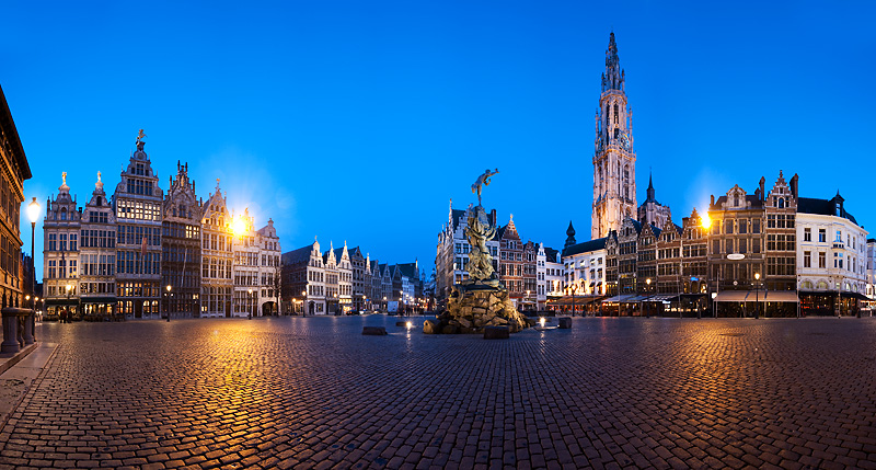 The guildhouses, Brabo Fountain, and the spires of the Cathedral of Our Lady from Grote Markt. - Antwerp, Belgium - Daily Travel Photos