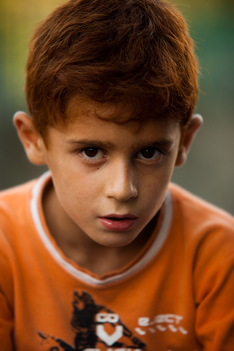 A young Kashmiri redhead poses for a portrait. - Srinagar, Kashmir, India - Daily Travel Photos