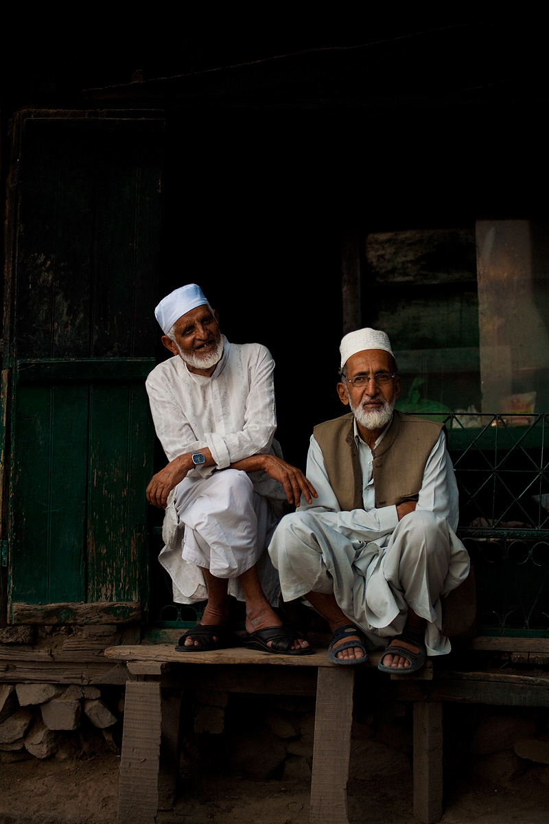 A pair of Kashmiri shopkeepers sit idle on a day of general strikes. - Srinagar, Kashmir, India - Daily Travel Photos