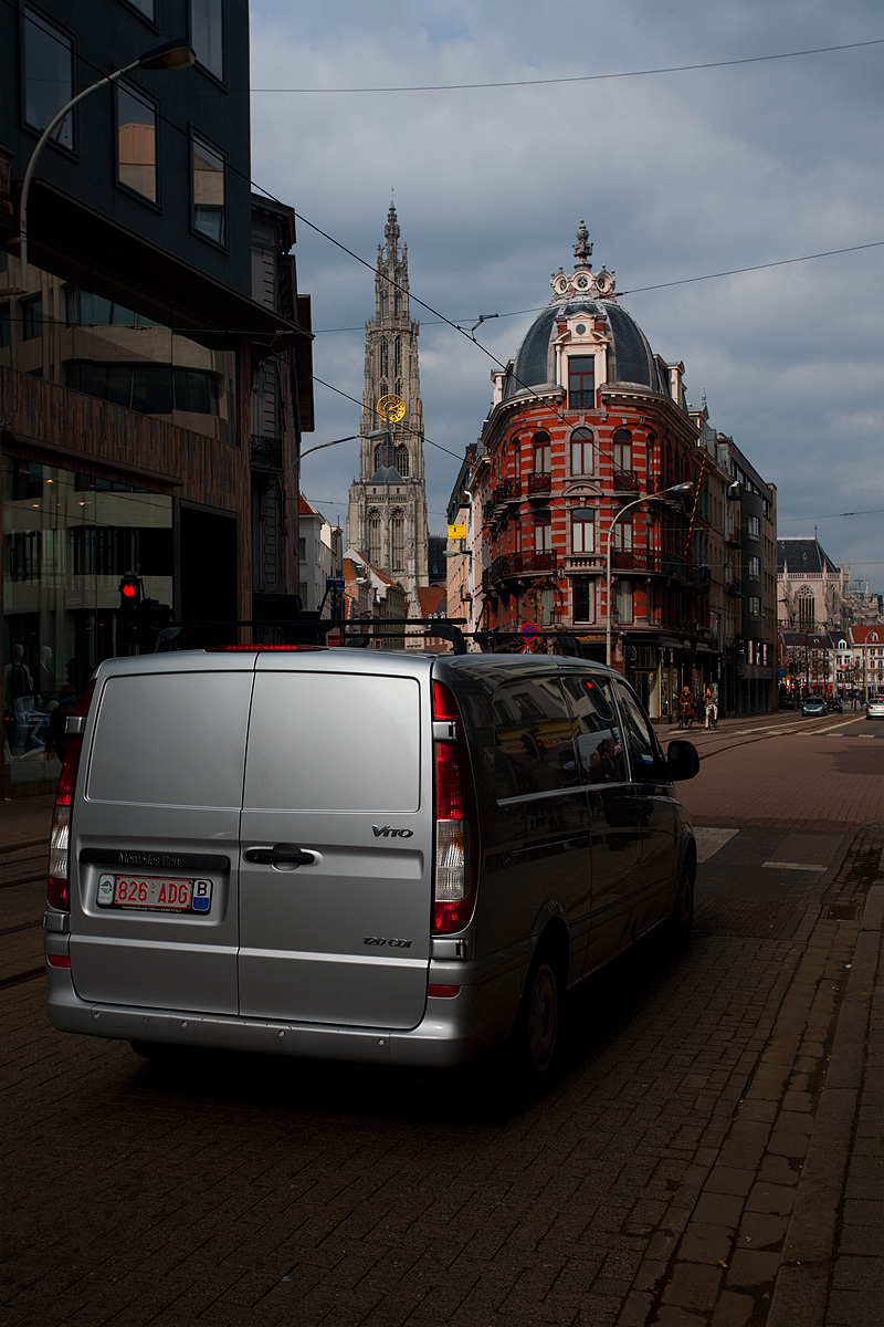 A van waits at a three way intersection near Groenplaats and the Cathedral of Our Lady. - Antwerp, Belgium - Daily Travel Photos