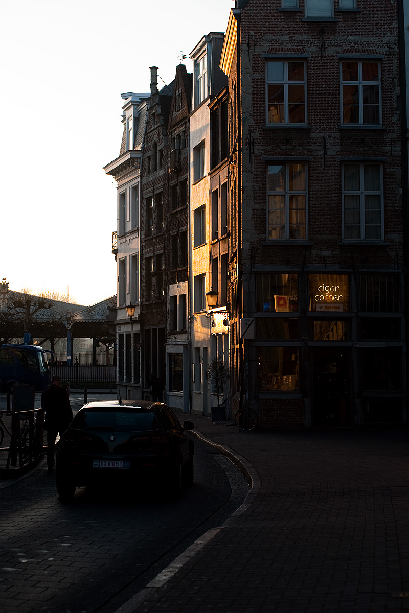 A car maneuvers down a typical European alley toward the Scheldt River. - Antwerp, Belgium - Daily Travel Photos