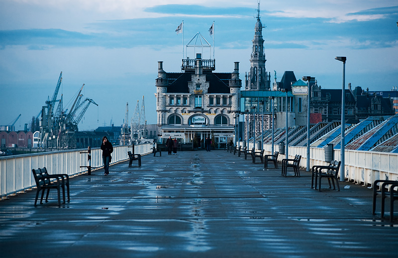 The port of Antwerp's cranes are seen idle in the background. - Antwerp, Belgium - Daily Travel Photos