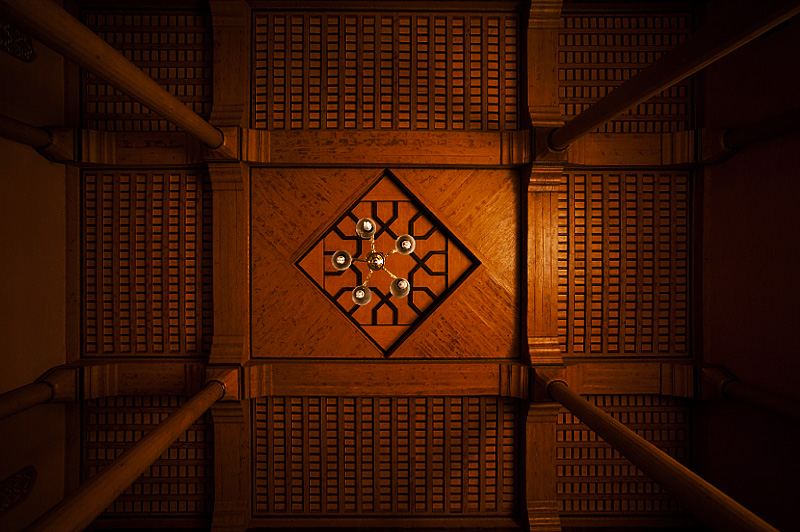 A chandelier and carved ceiling of one area of Srinagar's Jamia Masjid (Main Mosque). - Srinagar, Kashmir, India - Daily Travel Photos