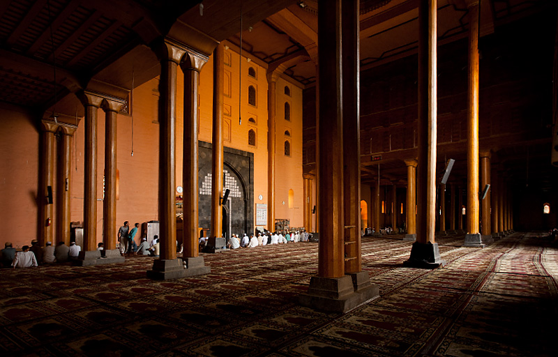 Muslims sit for prayer in the immense prayer hall of Jamia Masjid. - Srinagar, Kashmir, India - Daily Travel Photos