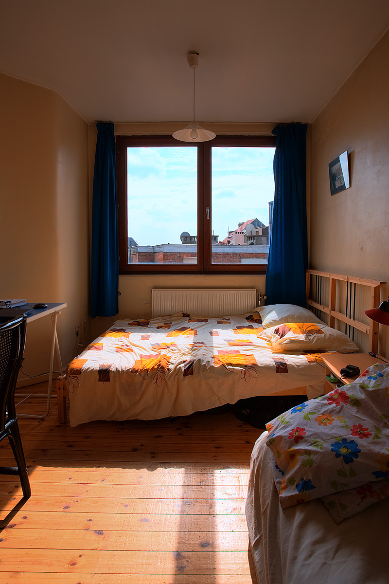 A bed in a European studio apartment. - Antwerp, Belgium - Daily Travel Photos