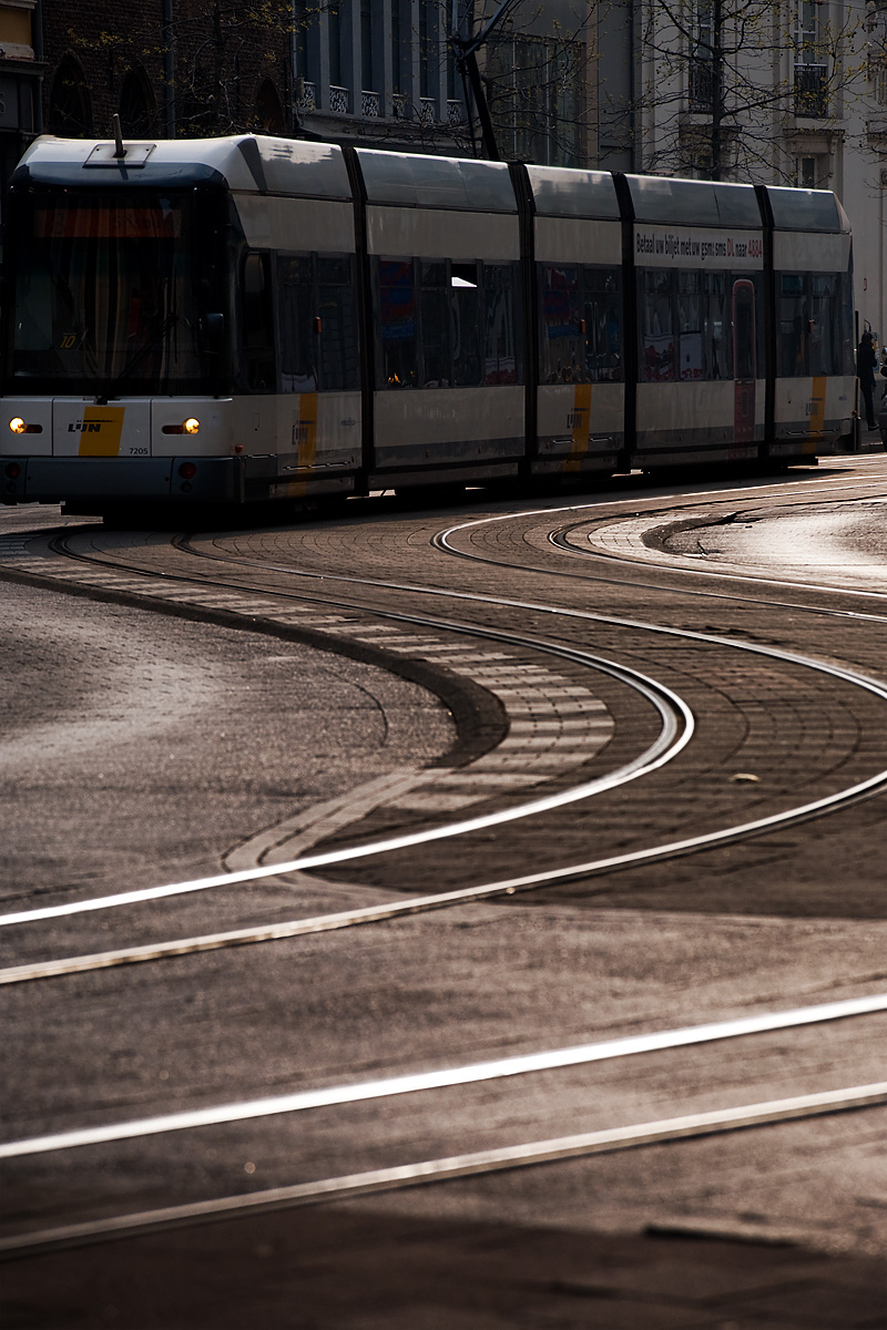 A tram snakes along an S-curve set of tracks. - Antwerp, Belgium - Daily Travel Photos