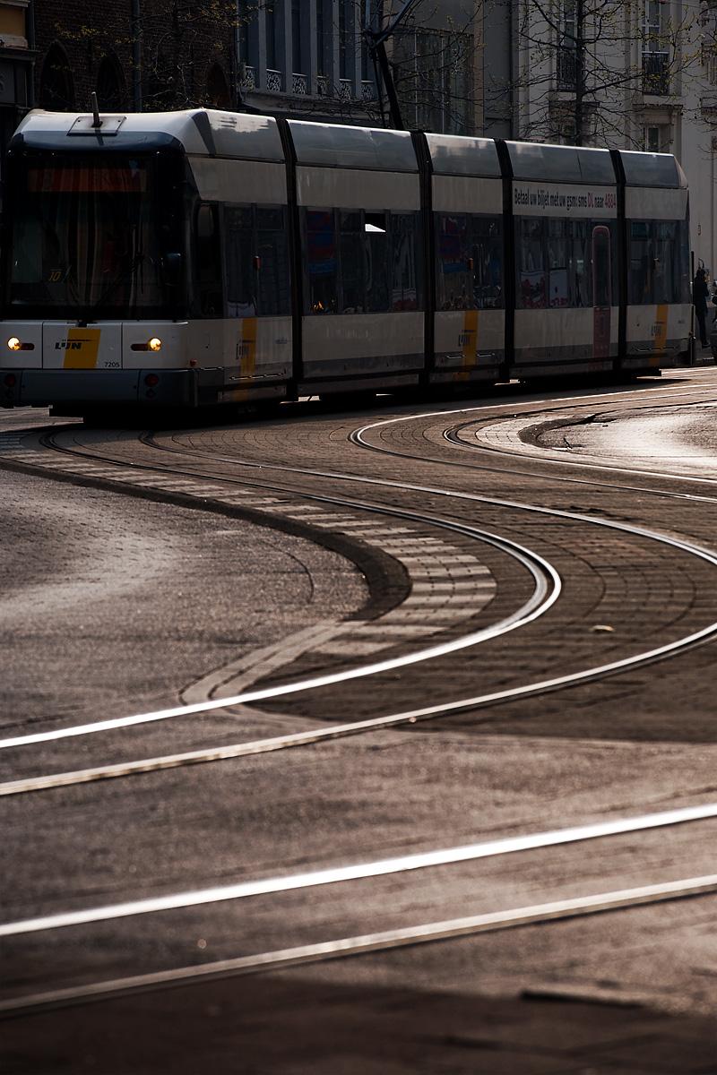 A tram snakes along an S-curve set of tracks. - Antwerp, Belgium - Daily Travel Photos