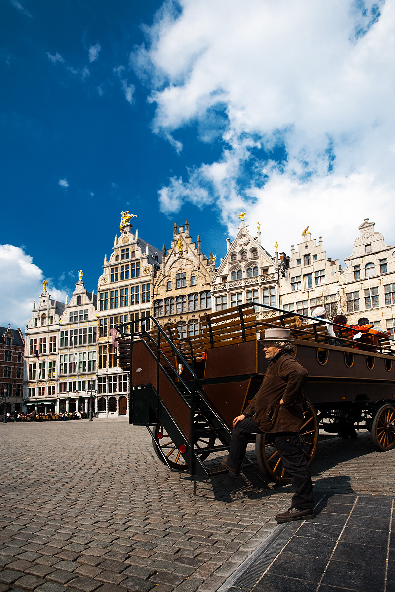 A tourist sightseeing carriage driver accidentally poses for a photograph in Grote Markt Square. - Antwerp, Belgium - Daily Travel Photos