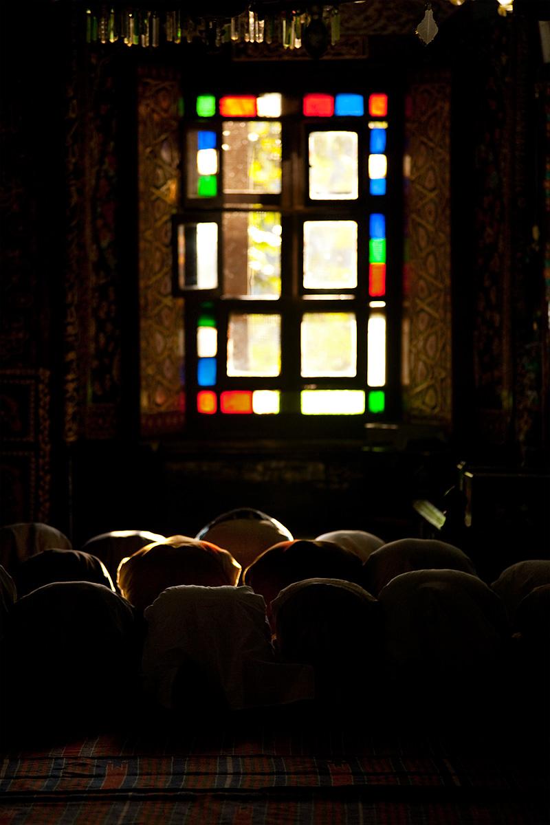Muslim men bow in prayer inside the beautifully ornate Shah-e-Hamdan mosque. - Srinagar, Kashmir, India - Daily Travel Photos