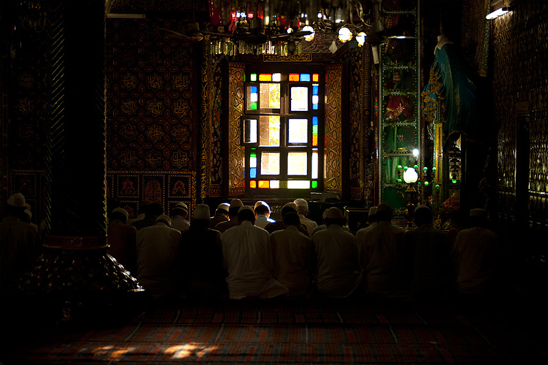 Muslim men kneel in prayer inside the ornately decorated Shah-e-Hamdan mosque. - Srinagar, Kashmir, India - Daily Travel Photos
