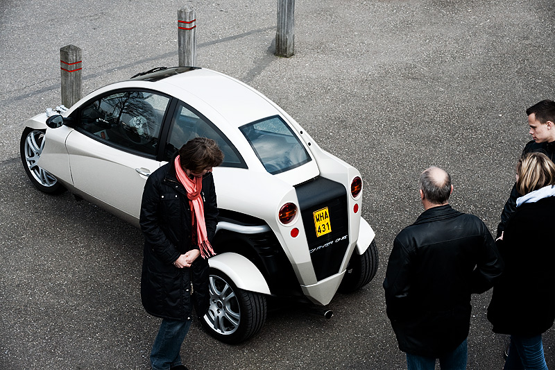 The Carver One three-wheeled vehicle attracts some casual gawkers' attention. - Antwerp, Belgium - Daily Travel Photos