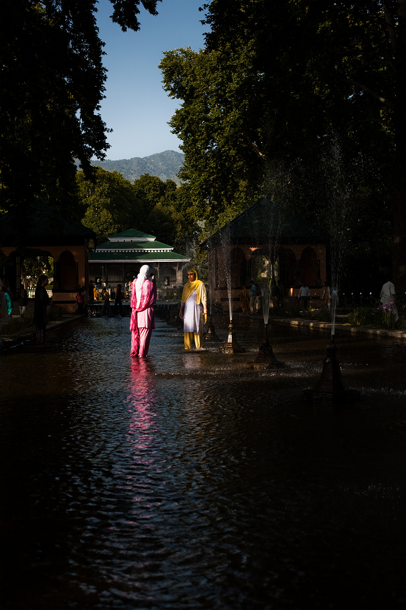 Kashmiri women stand in Shalimar Bagh's water fountain. - Srinagar, Kashmir, India - Daily Travel Photos