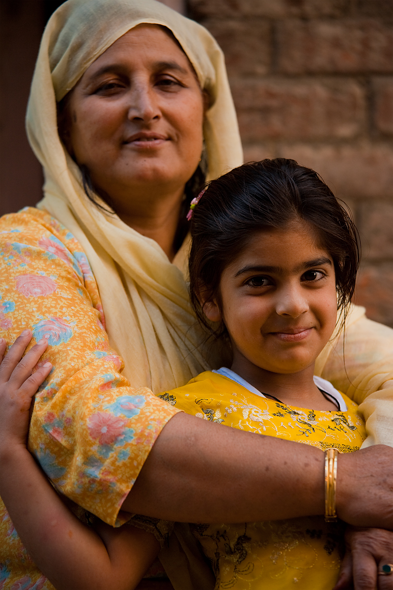 A Kashmiri mother and daughter pose for a portrait. - Srinagar, Kashmir, India - Daily Travel Photos