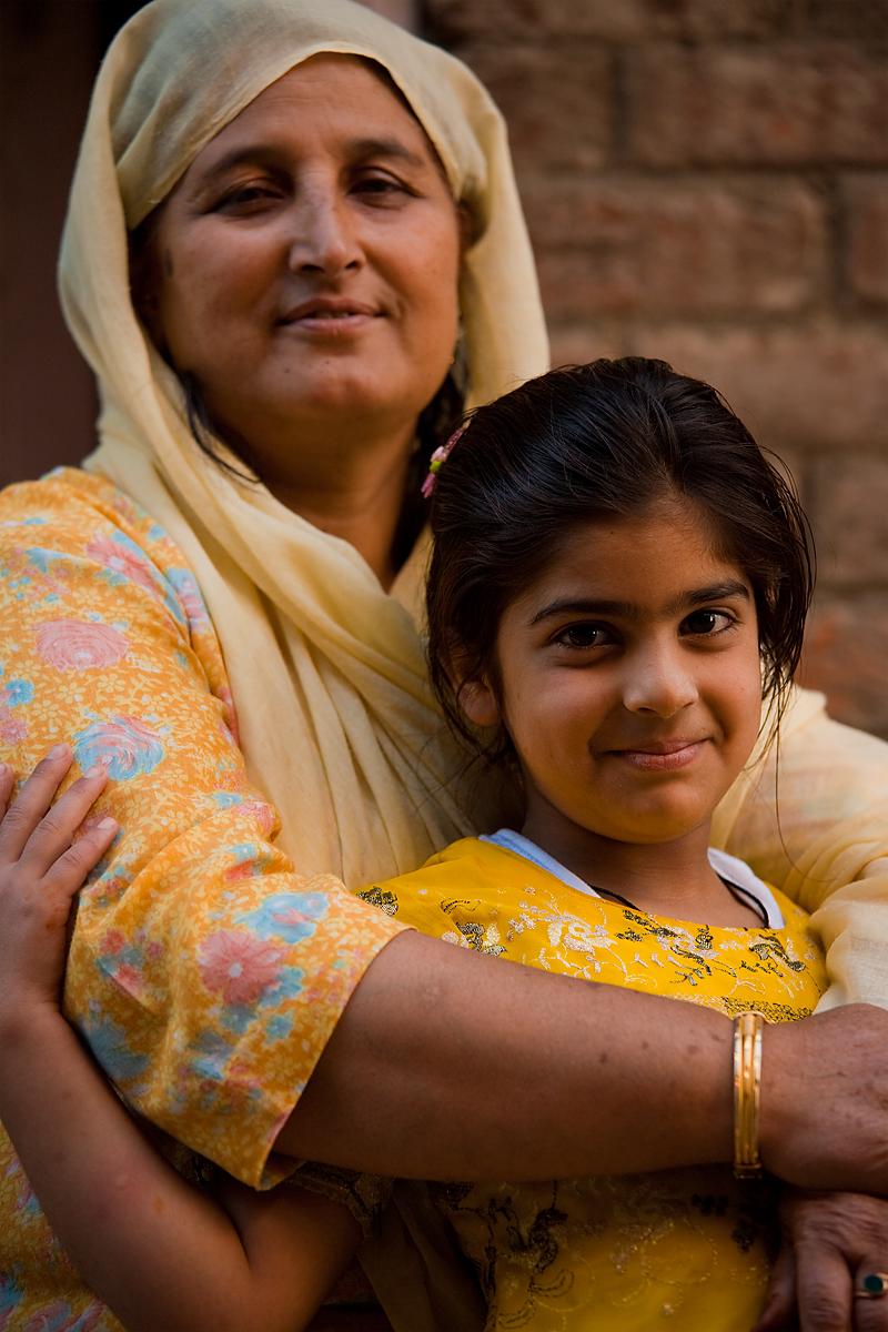 A Kashmiri mother and daughter pose for a portrait. - Srinagar, Kashmir, India - Daily Travel Photos