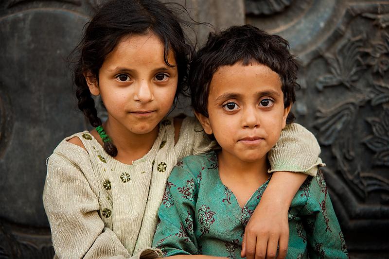 Young Kashmiri girls embracing for a portrait. - Srinagar, Kashmir, India - Daily Travel Photos